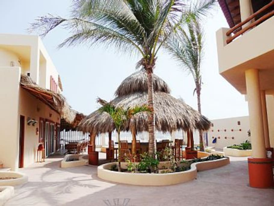 Main building, palapa bar, guest building from property entrance
