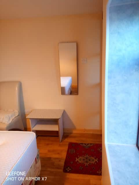 Bright two bedroom accommodation with sunroom