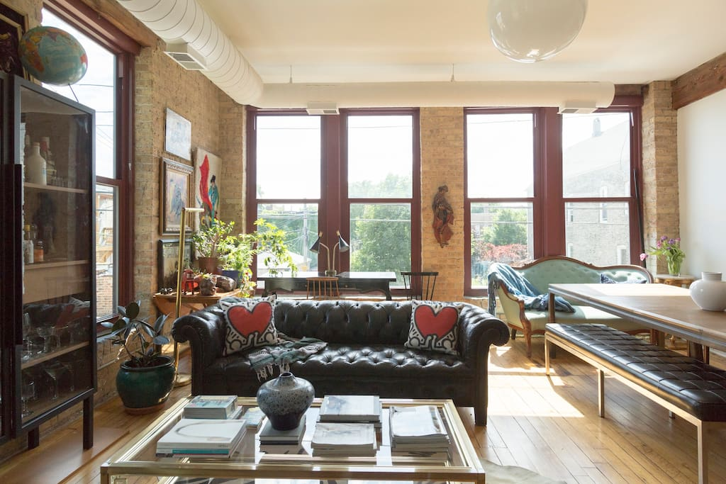Cool living area includes a vintage English Chesterfield Sofa.