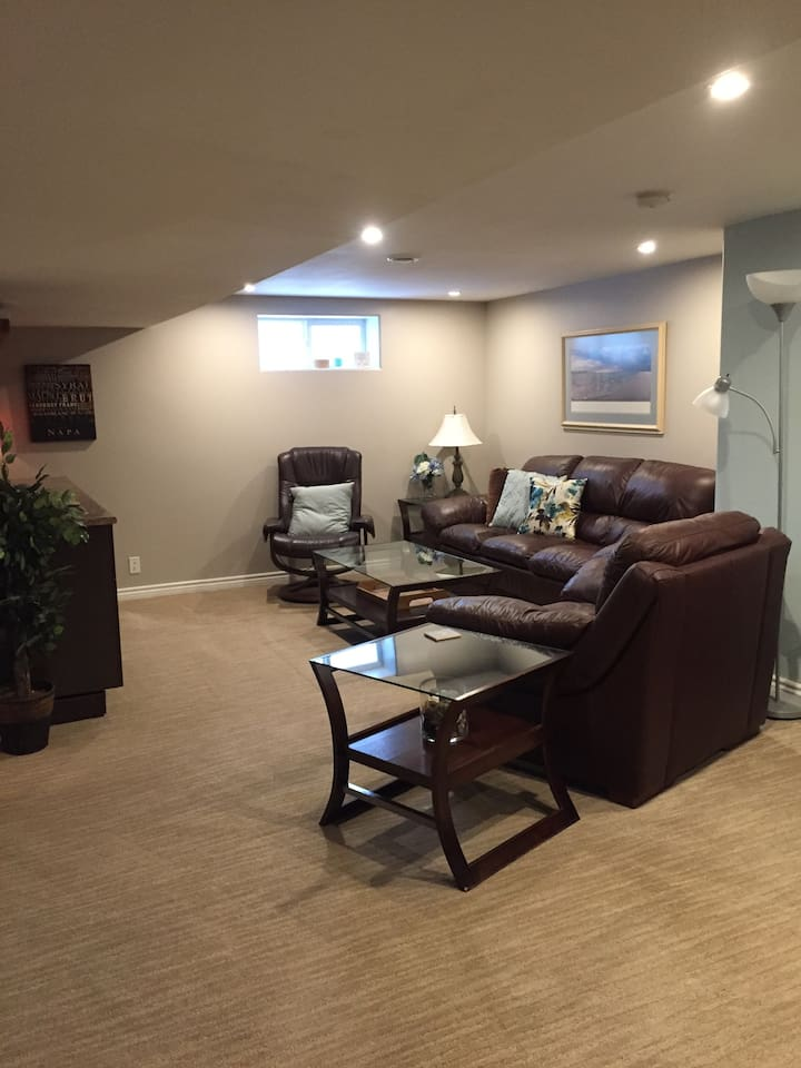 Lounge around in our spacious living area. The renovated space has comfortable leather furniture, a wet bar area with wine fridge, big screen TV with Netflix and electric fireplace. Home away from home.