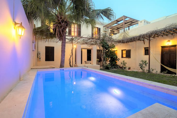 Room in stylish villa with pool