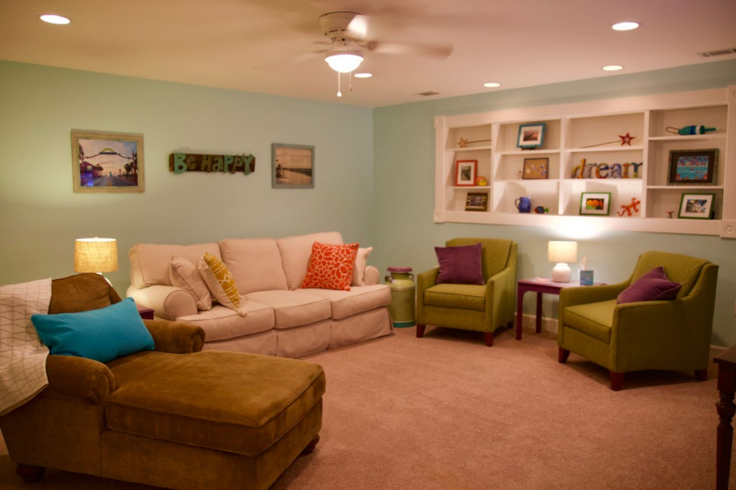Colorful, inviting, comfortable living room with new furniture.  Sofa contains queen-size bed without the bar in your back!