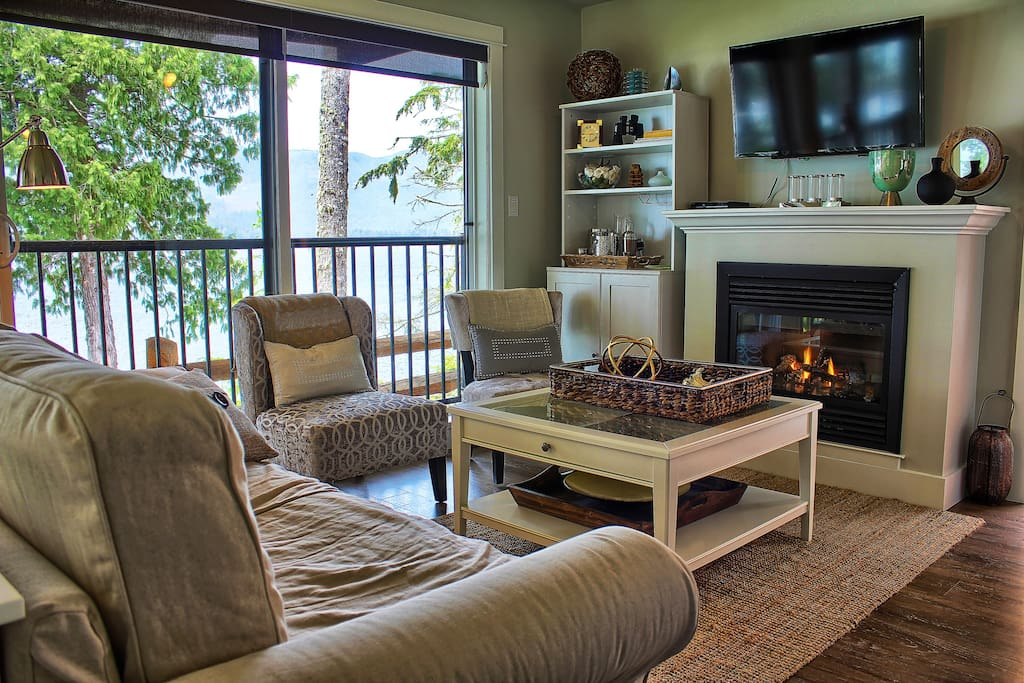 Oceanfront suite living room with cozy gas fireplace.