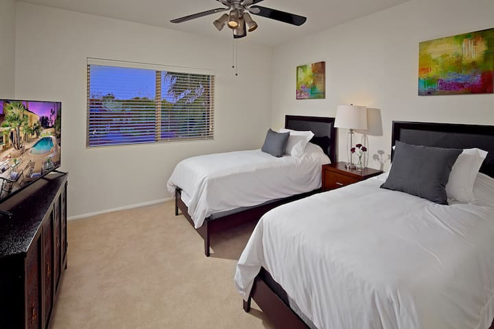Bedroom 2: (2) Comfy twin beds, private TV. Located Upstairs.