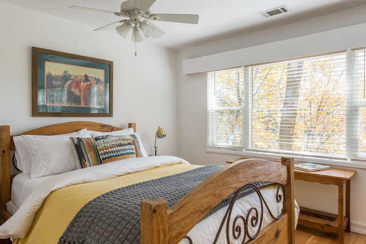 Queen bedroom with lake view.  This queen bed had a down comforter, heated mattress pad and hotel quality linens.