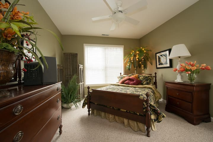 Bedroom number 2 is cozy sleeping with the palm leaves and tivoli lights.