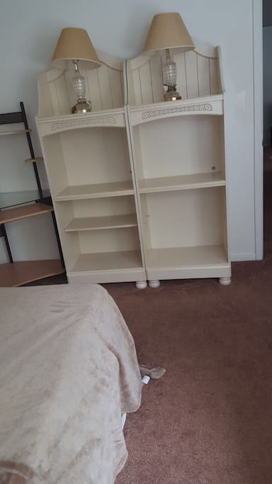 Desk and book shelves which could be use for clothes.