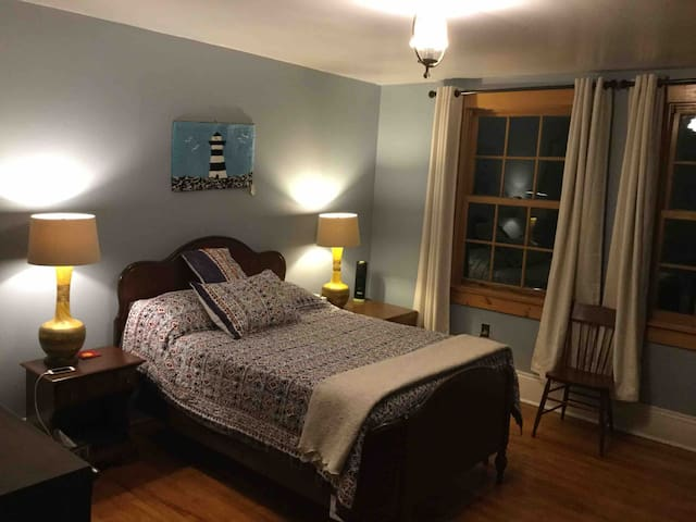 Master bedroom with double bed, quality linens and black out curtains for a good rest.