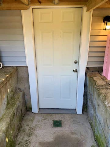 Shared backyard entrance. This door leads in from the backyard, through the common area near the laundry, and into the private entrance to the in-la suite! Both doors have safe deadbolts with separate keying.