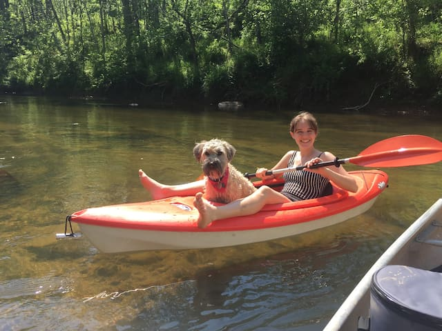 Our daughter and her dog Nina kayaking down The Rockfish River.