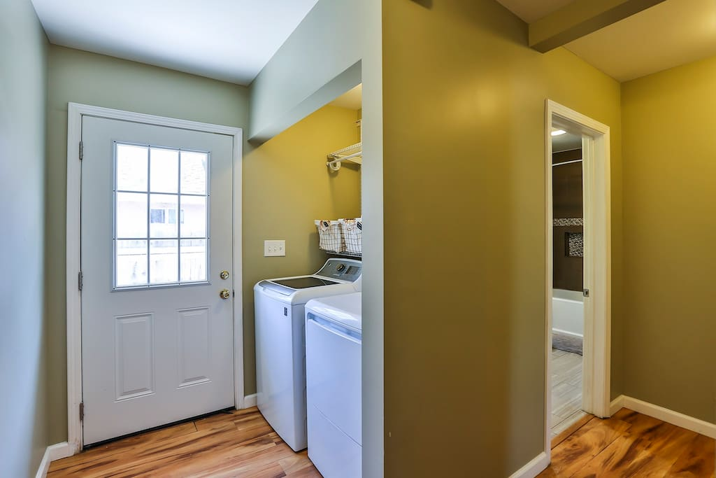 Laundry room and hallway that separates the front 2 bedrooms from the master bedroom for added privacy.