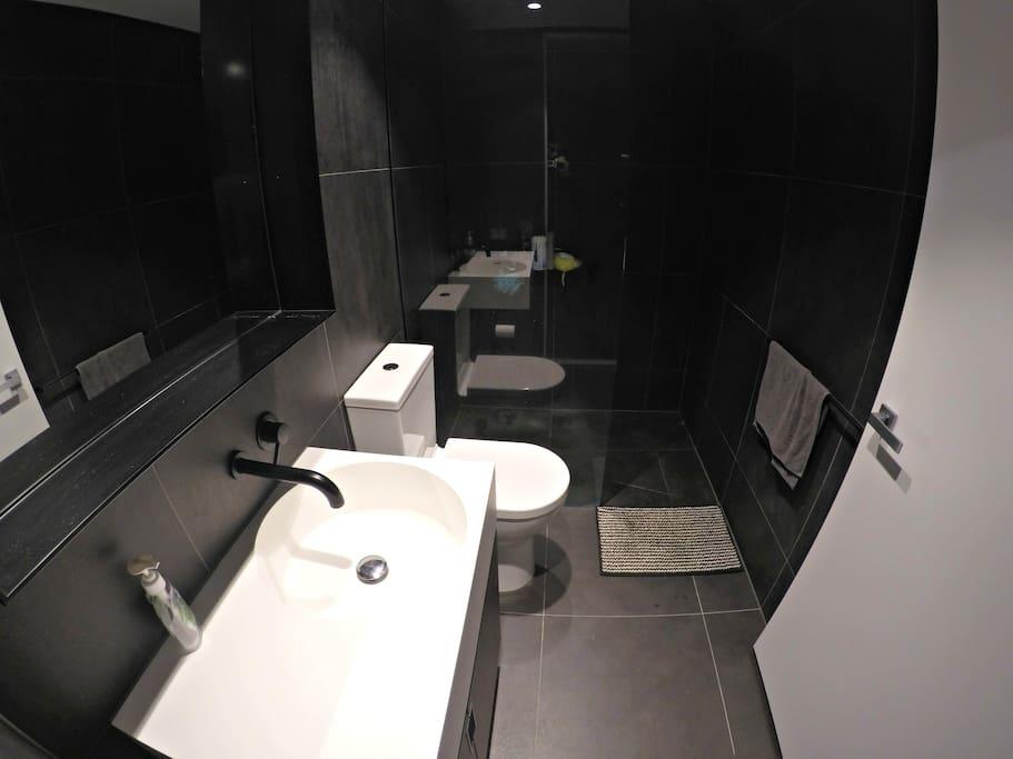 Bathroom with hidden door for washing machine