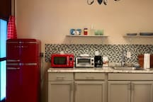 Kitchenette is fully stocked with fridge/freezer, microwave, toaster oven, electric kettle, toaster, electric burner/stovetop, coffee maker + filter + coffee, utensils, silverware, dishes, pots and pans, cutting board, can opener, wine opener, etc.
