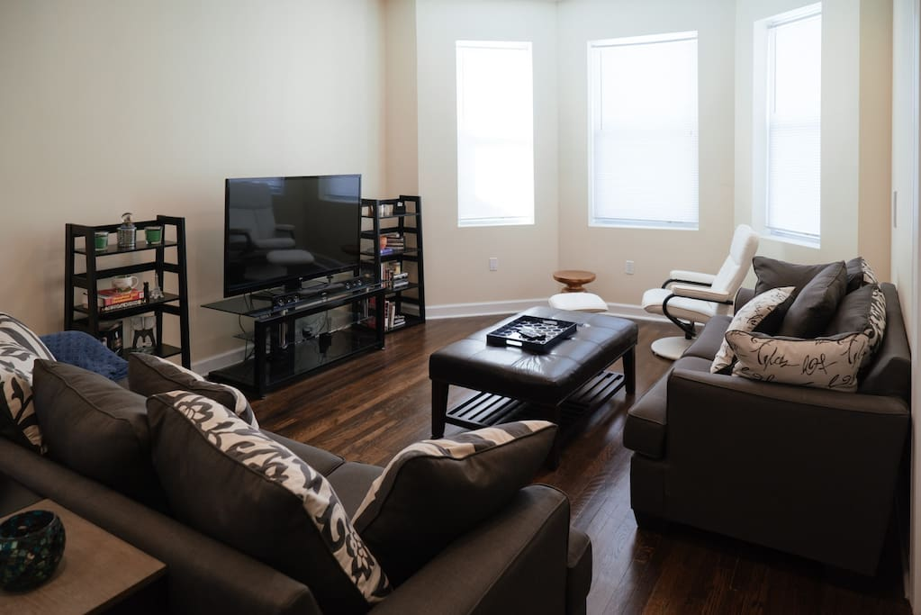 Living room with sofas and chair with leg rest.