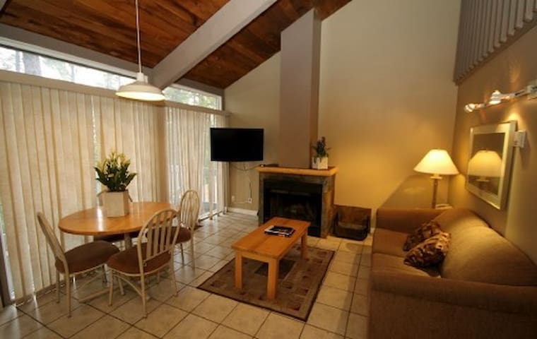Gorgeous vaulted ceilings and a spacious living area make this condo perfect for a family. Photos are representative.