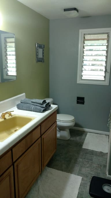 Bathroom with fresh towels and vintage sink.