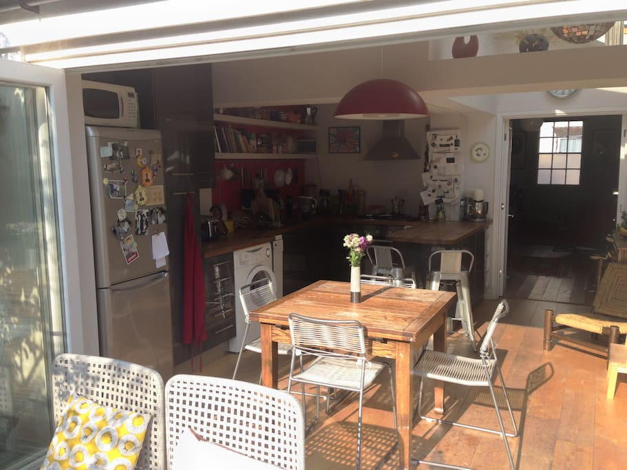 Bright extended kitchen with folding doors opening onto the garden