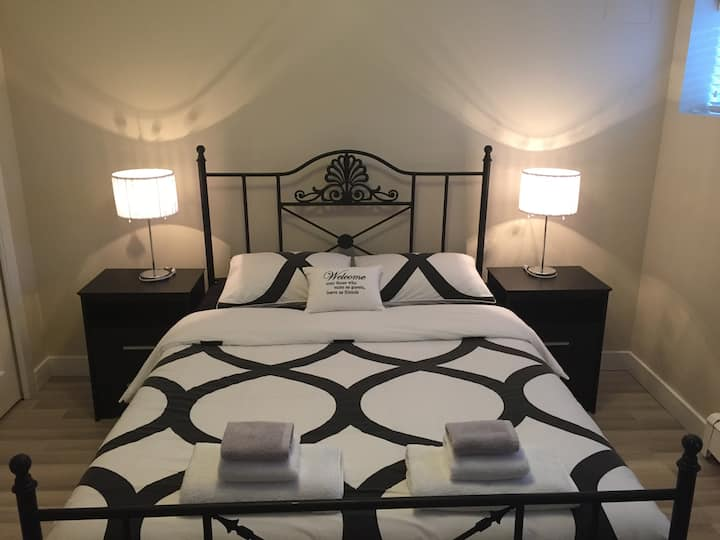 Queen bedroom with private bathroom.