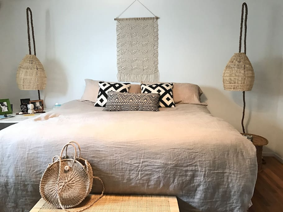Large spacious back bedroom, very private, king size bed, TV cable, 2 large windows in bedroom, one looks out to lanai/yard.  Sunny , open and airy. High thread count bedding. We provide ample closet space and dresser drawers for guests.