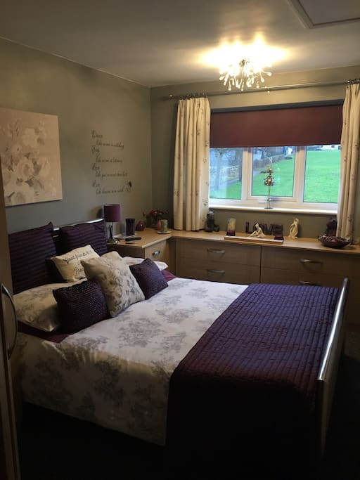 The king size bed in the en suite room