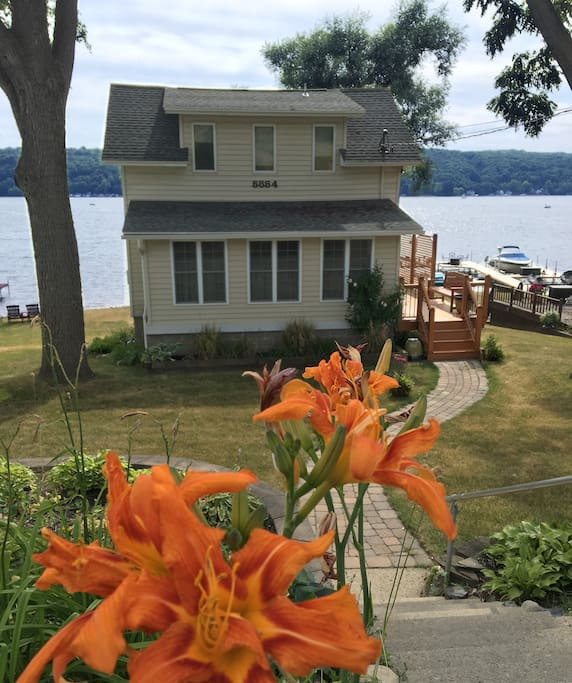 Newly updated 3-story home is tucked away for a private lakefront getaway.