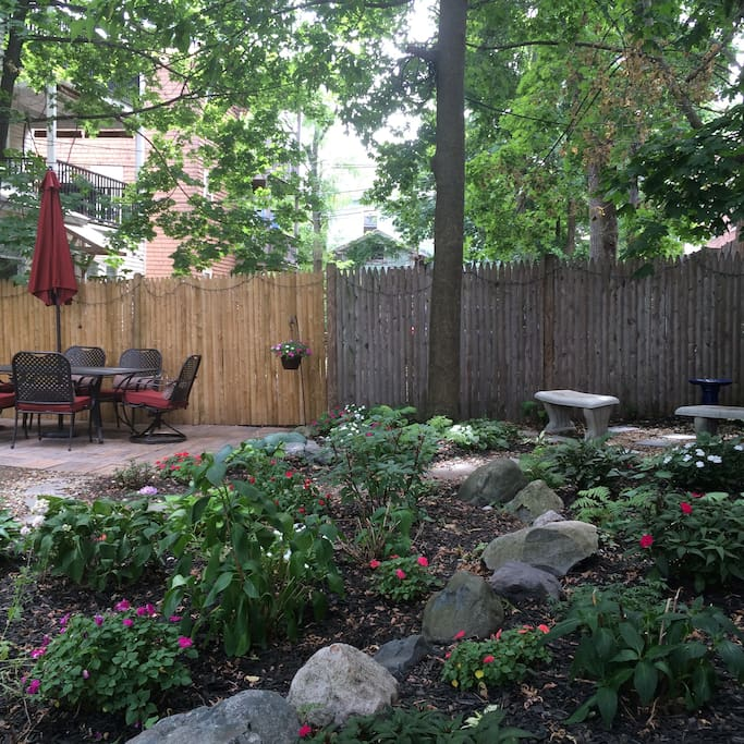 Back yard with double hammock, grill, and ample seating area
