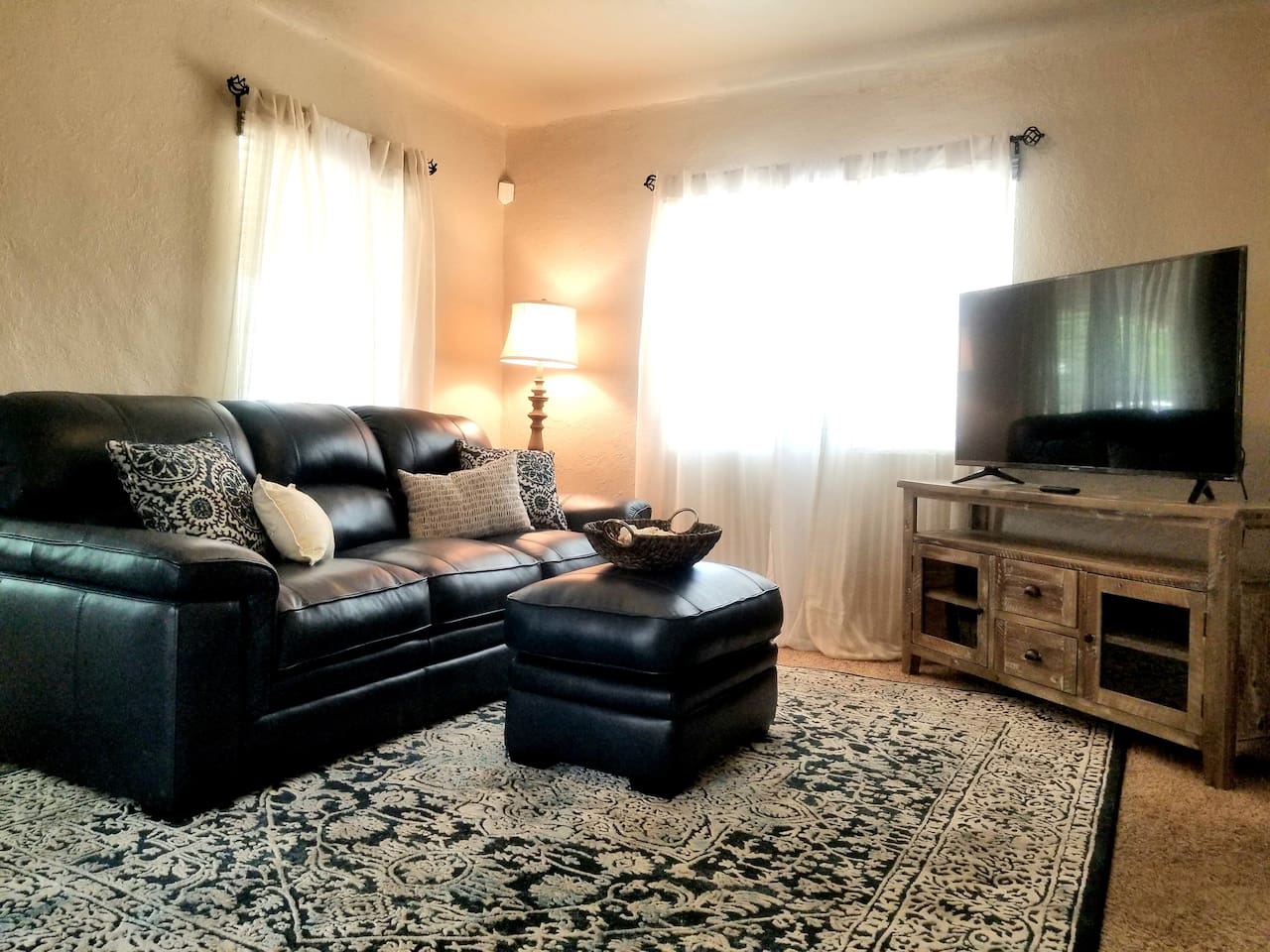 """Living room with a super comfy couch and 55"""" smart television."""