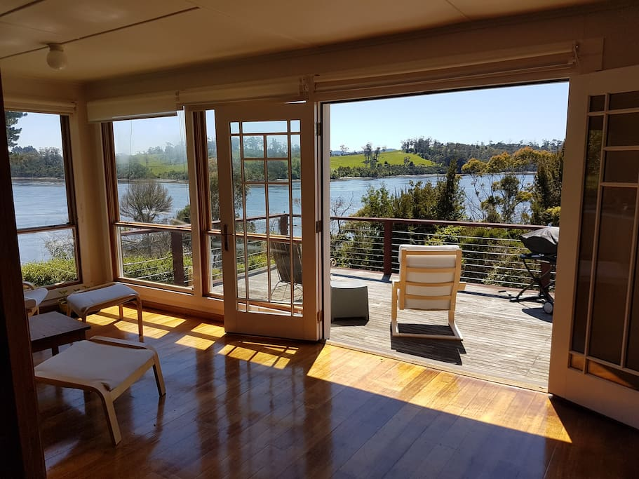 Double glazed french doors open onto the deck