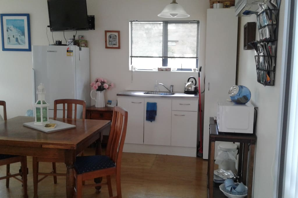 Small Kitchenette with Fridge and Microwave only. Pantry with Coffee and a selection of Tea. Toaster and Kettle provided.