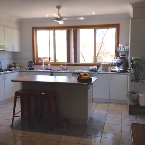 Large kitchen that overlooks a birdbath garden. Available for light meal preparation only.