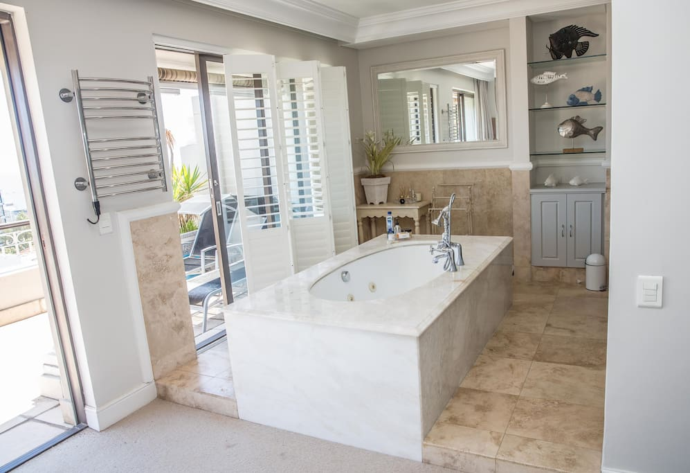 Master bathroom - open plan full bathroom with sea views, private loo