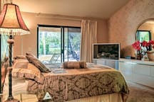You'll have easy access to the patio through the sliding glass doors in this bedroom!
