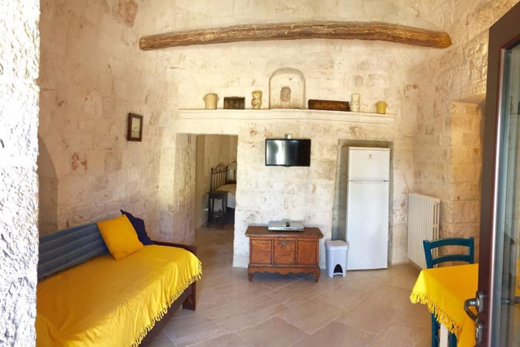This Historic Trullo room features a twin day bed, TV, DVD player, Refrigerator and freezer, bistro table/chairs for 2, microwave.