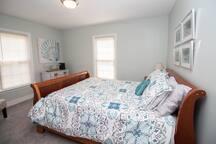 Queen sleigh bed in ocean themed room.