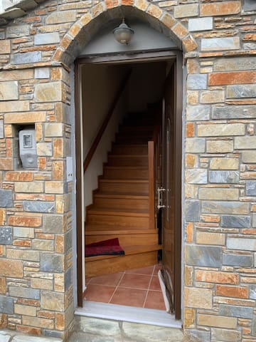 private entrance of the house with a wooden staircase