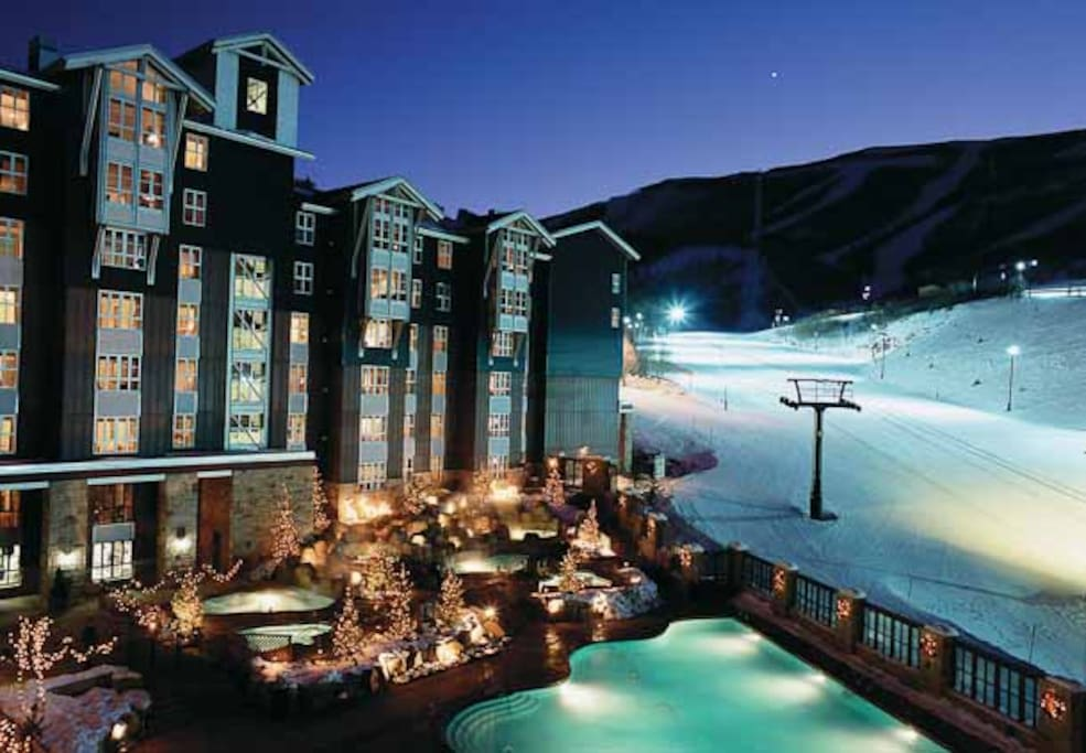 night view of the ski in ski out and pool area off of the main PC run