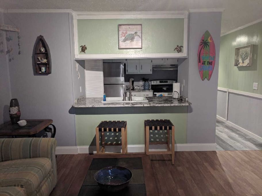 Kitchen area with bar.