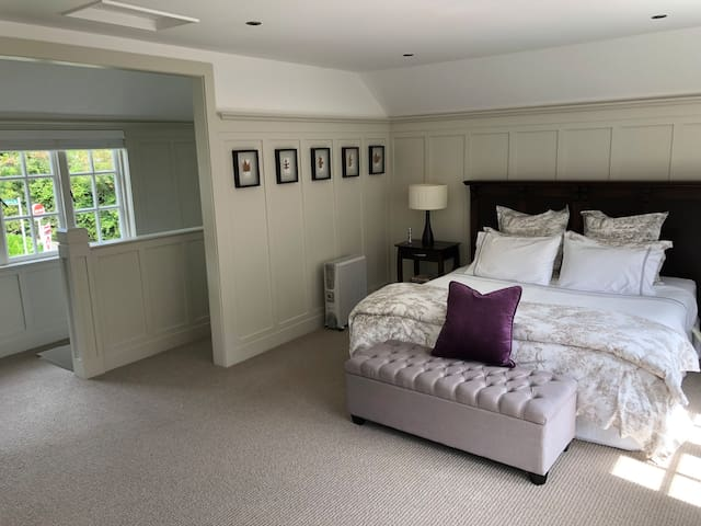The large sunny bedroom and Super King bed with Wallace Cotton linens.