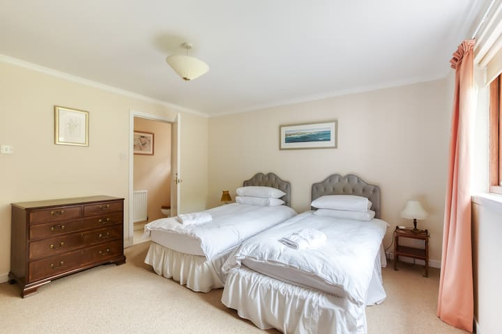Bedroom 4 - Ground floor twin room with views of the main lawn, en-suite toilet and separate shower and bath. It is a lovely quiet room as it is separated from the communal areas by a separate corridor