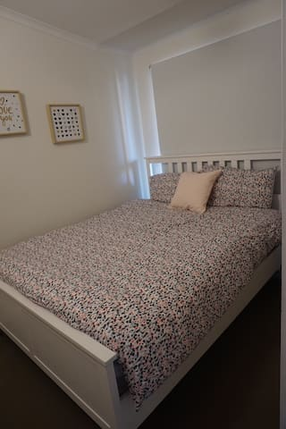 Bedroom with Queen size bed and blockout blinds