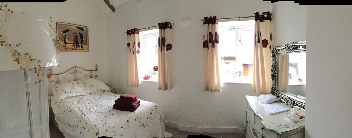 Lovely double room with own private bathroom .