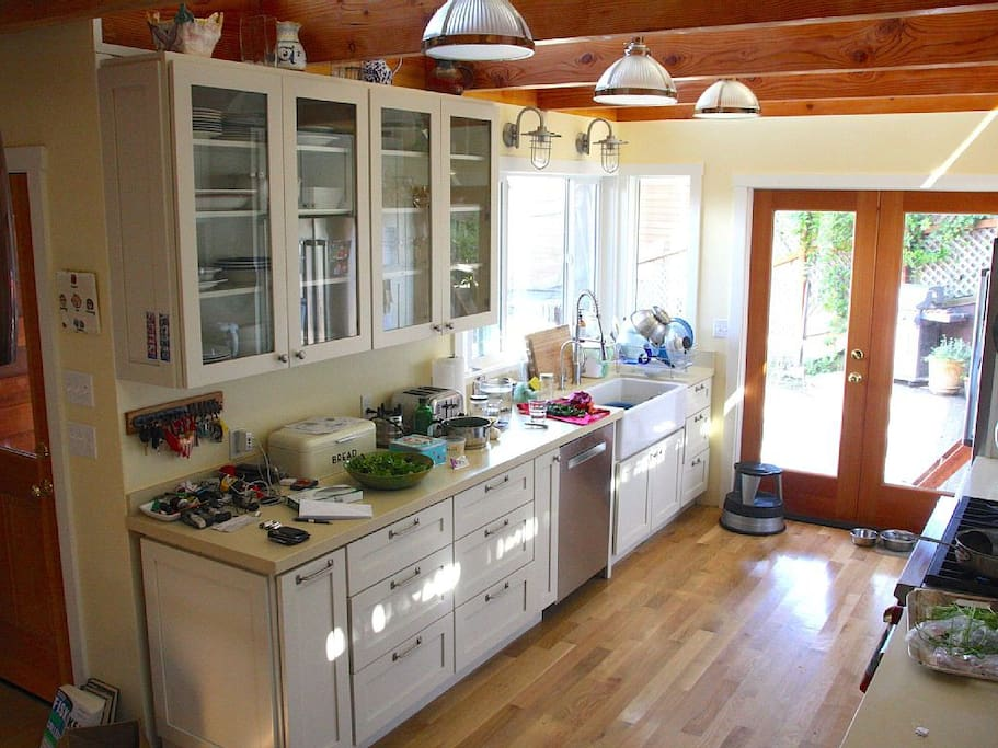 New kitchen with 6-burner Wolf range and access to patio.