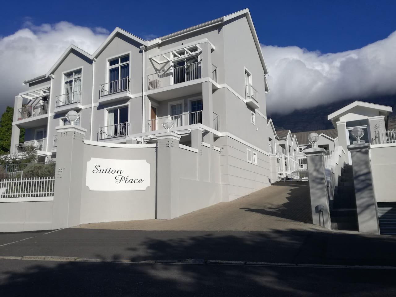 Sutton Place has Table Mountain as a backdrop. It's a secure residence with high walls, electric fencing and 24 hour security. There is also gated off-street parking.
