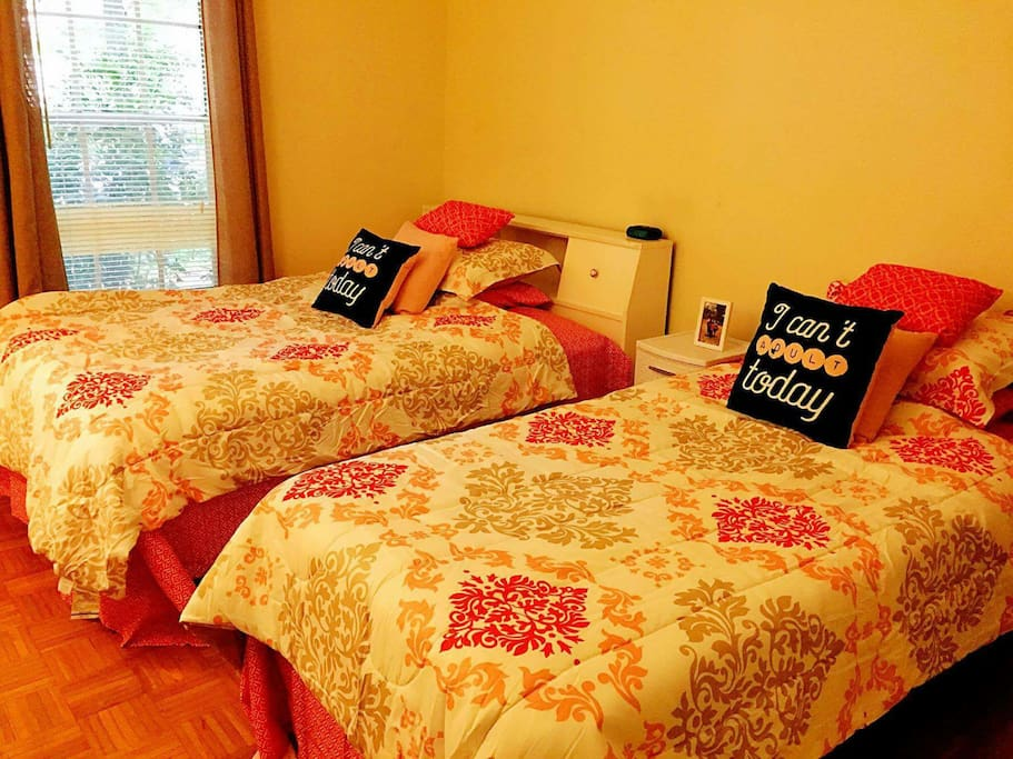 Full size bed and twin bed room