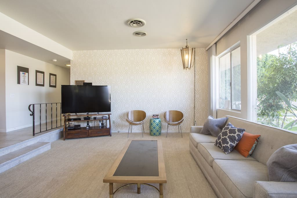Sunken living room with large flat screen TV (Apple TV, Netflix, Hulu)
