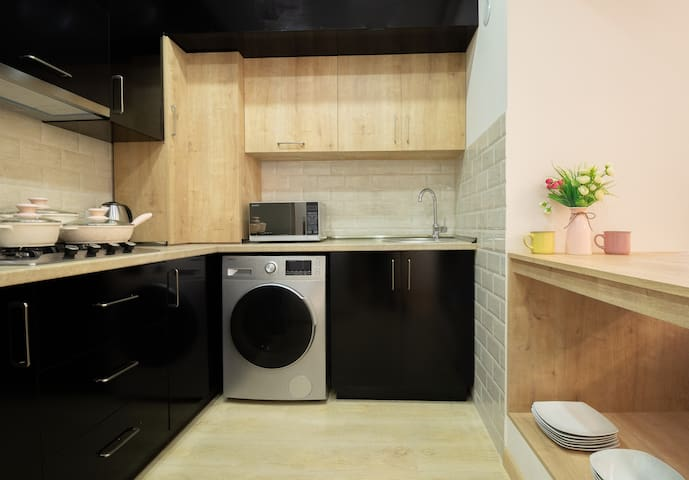 kitchen with full facilities microwave, washing machine.