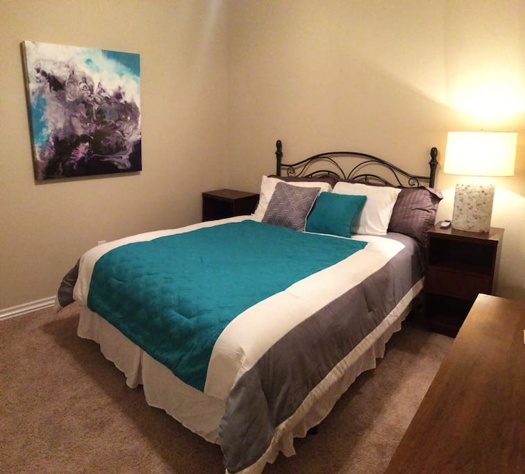 The second guest room with another queen bed!