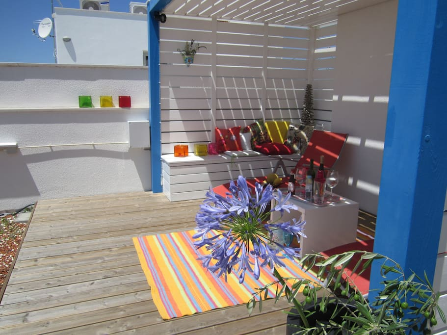 Sunny roof terrace with colourful planting