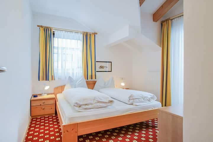 "Cosy Holiday Apartment ""Feldhof Mountains Latemar 112-2p"" with Wi-Fi, Garden & Wellness Area; Parking Available, Pets Allowed"
