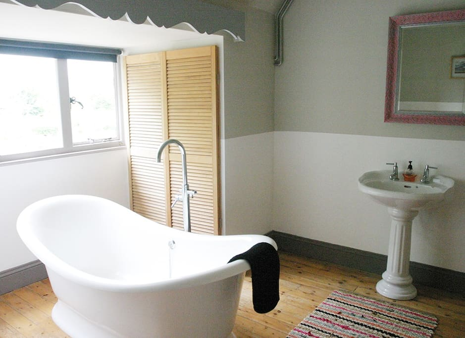 There are 2 Edwardian bathrooms. One has a bath shower.